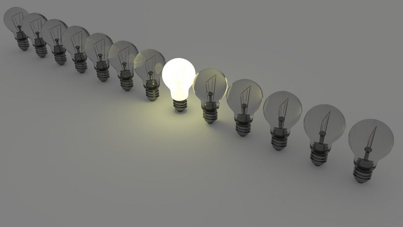 a light bulb showing how you can stand out by asking the right interview questions