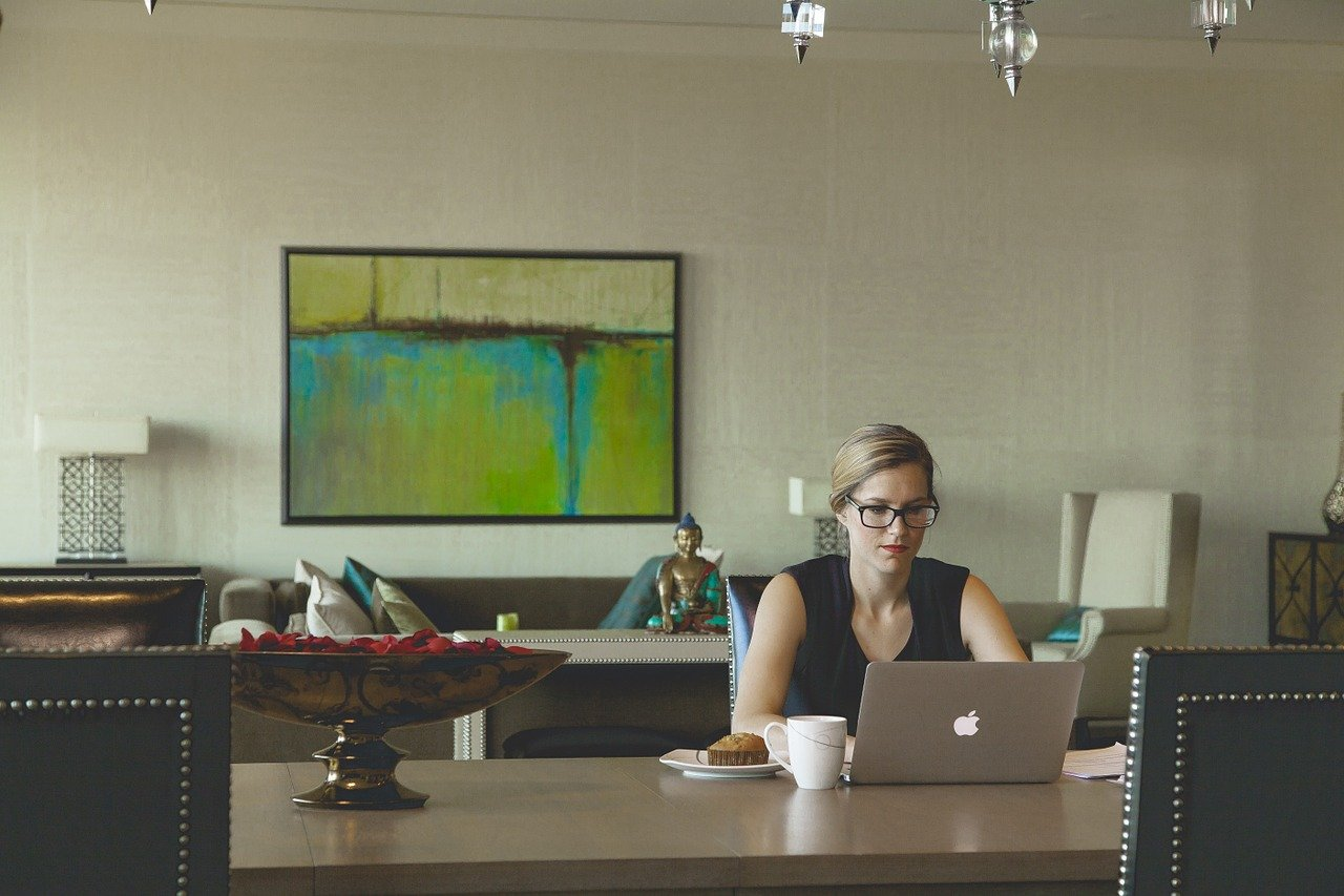 A woman working in IT on her laptop