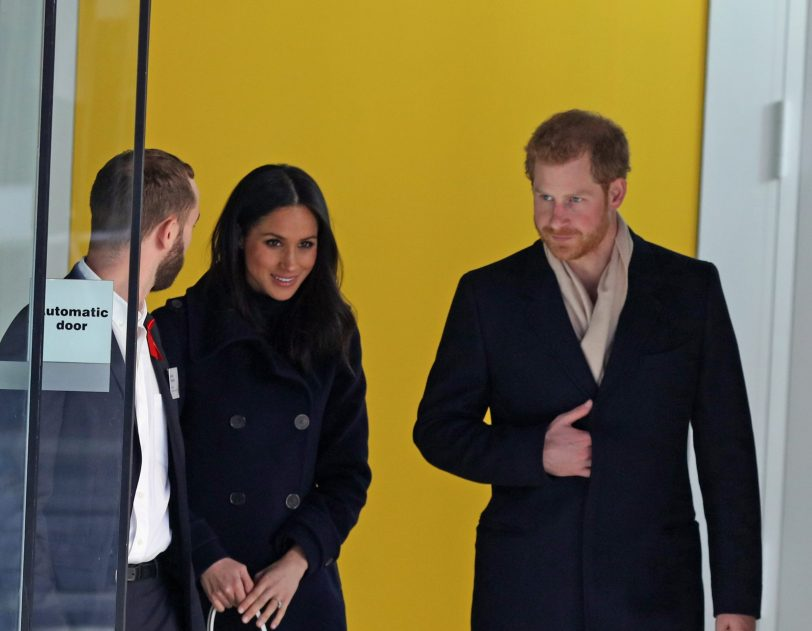 Harry and Meghan leaving a building