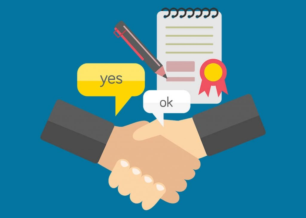 Two people shaking hands in front of contract document - IT employment process image